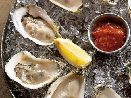 """<strong>Get the <a href=""""https://www.huffpost.com/entry/ldquonuderdquo-raw-oy_n_1061367"""">""""Nude"""" Raw Oysters with Sauces</a> r"""