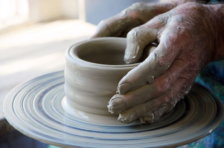 the creation of pottery on wheel