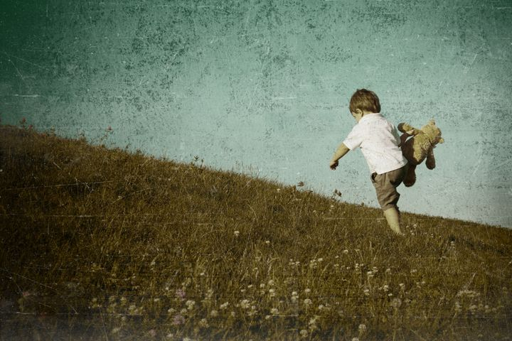 young boy climbing hill