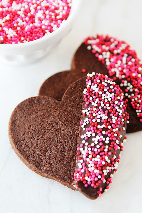 "<strong>Get the <a href=""http://www.twopeasandtheirpod.com/chocolate-shortbread-heart-cookies/"" target=""_blank"">Chocolate Sho"