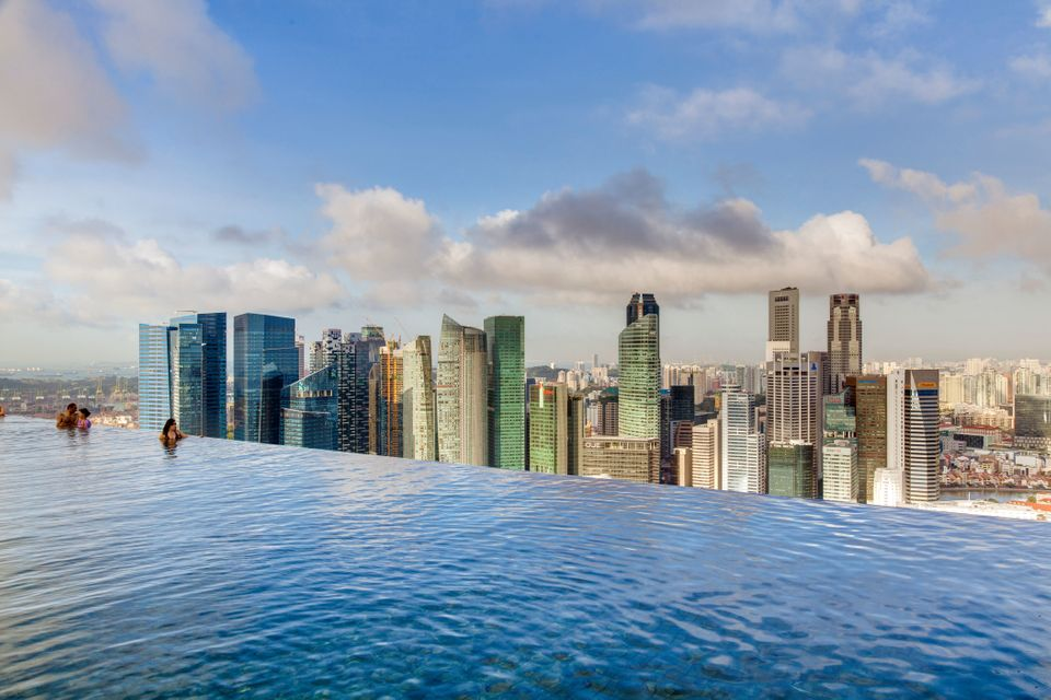 """Warning: If you're at all terrified of heights, we suggest staying out of this pool. The <a href=""""http://www.marinabaysands.c"""