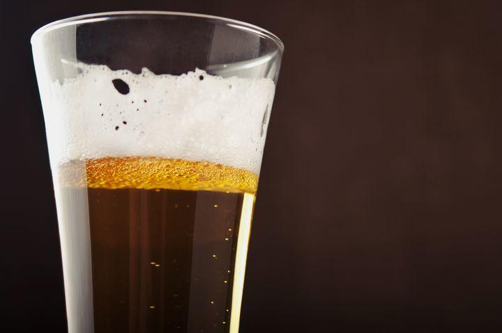 glass of beer on black...