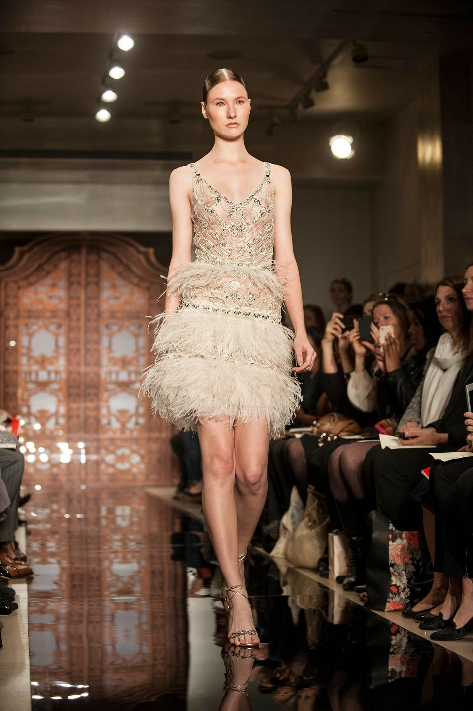 "A cafe-colored <a href=""http://www.reemacra.com/"">Reem Acra</a> gown."