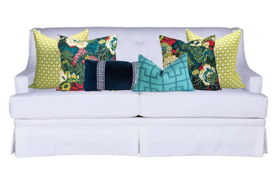 For her white sofa, Stein chose 2 Betwixt Pillows, a Bleeker Pillow, a Navy Greek Key Lumbar Pillow and 2 Custom Pillow in Sc