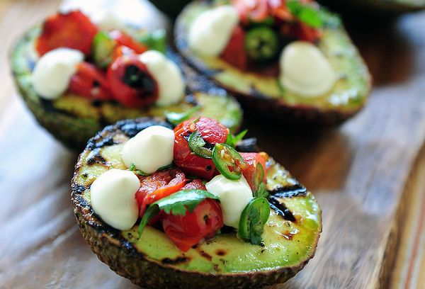 """<strong>Get the <a href=""""http://kalamazoogourmet.com/lifestyle/recipes/grilled-avocadoes-filled-with-blistered-tomato-salsa/#"""