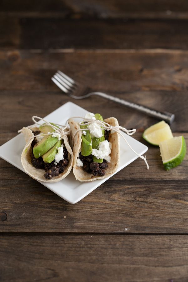 """<strong>Get the <a href=""""http://naturallyella.com/2012/06/06/spiced-black-bean-grilled-avocado-and-goat-cheese-tacos/"""">Spiced"""