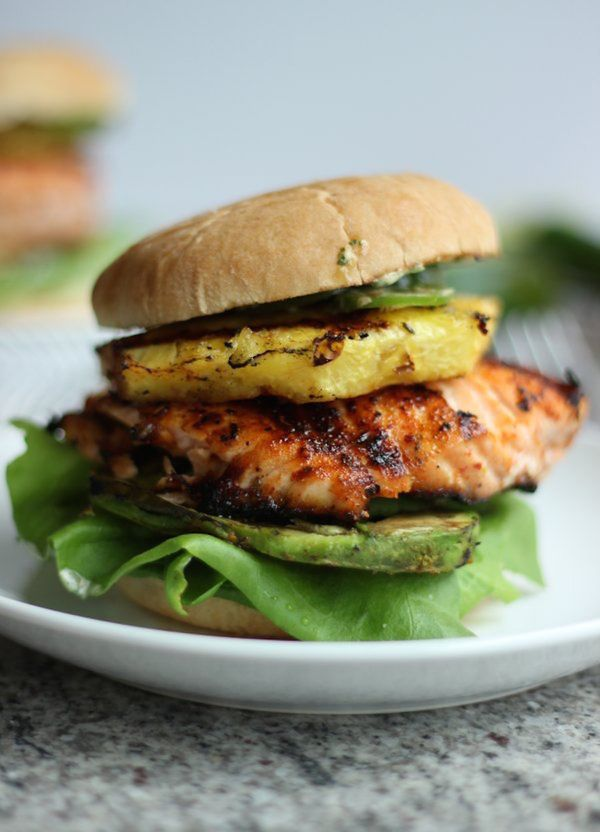 """<strong>Get the <a href=""""http://wickedspatula.com/tropical-salmon-burgers-grilled-pineapple-avocado/"""">Tropical Salmon Burgers"""
