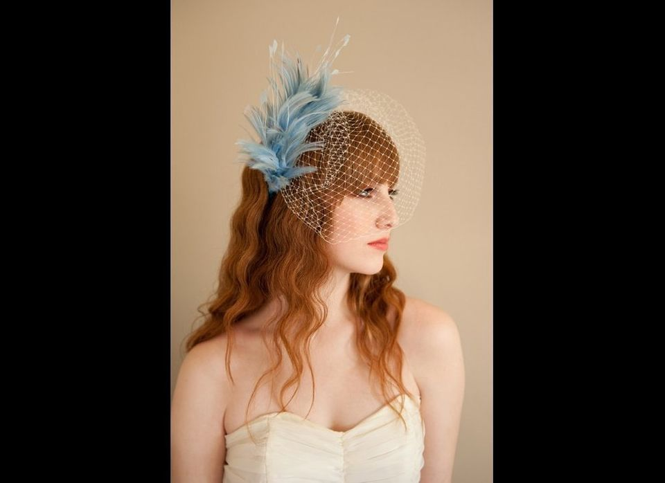 """The blue feathers on this veil add a pretty retro flair to your wedding day.<br><a href=""""http://lover.ly/search?e=0&q=birdcag"""