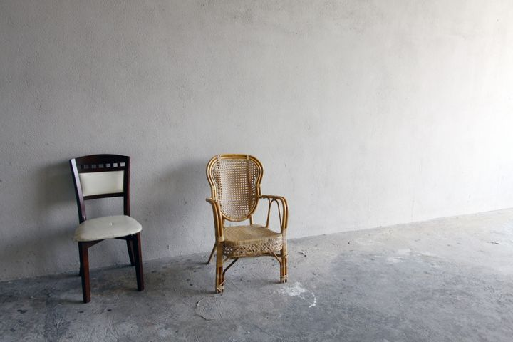 Lonely chairs in an isolated room, acts as background and backdrop