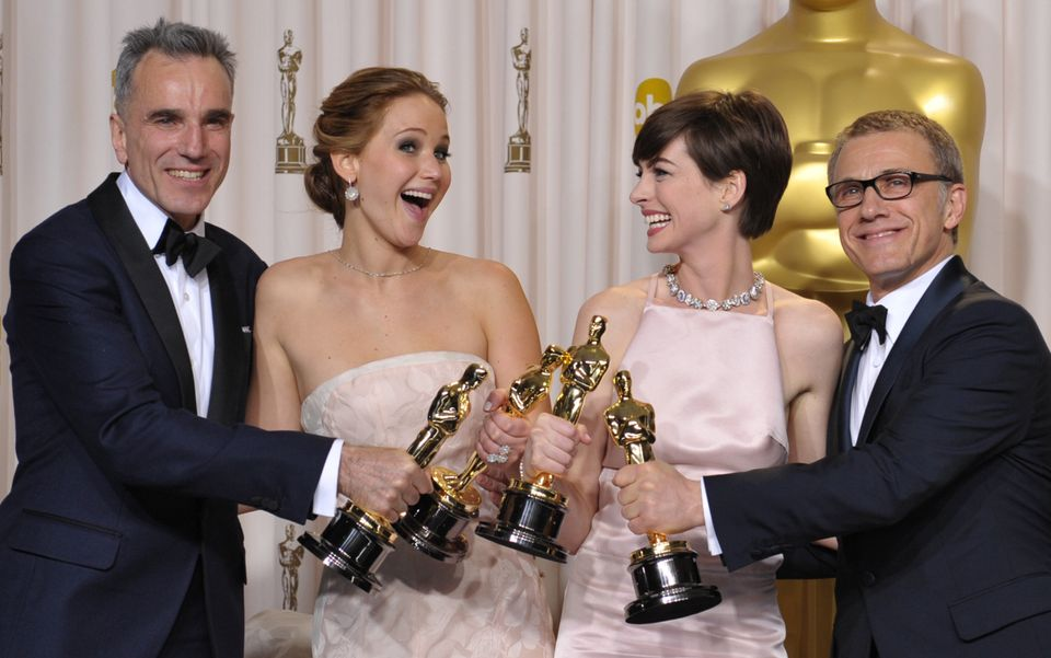 "From left, Daniel Day-Lewis, with his award for best actor in a leading role for ""Lincoln,"" Jennifer Lawrence, with her award"