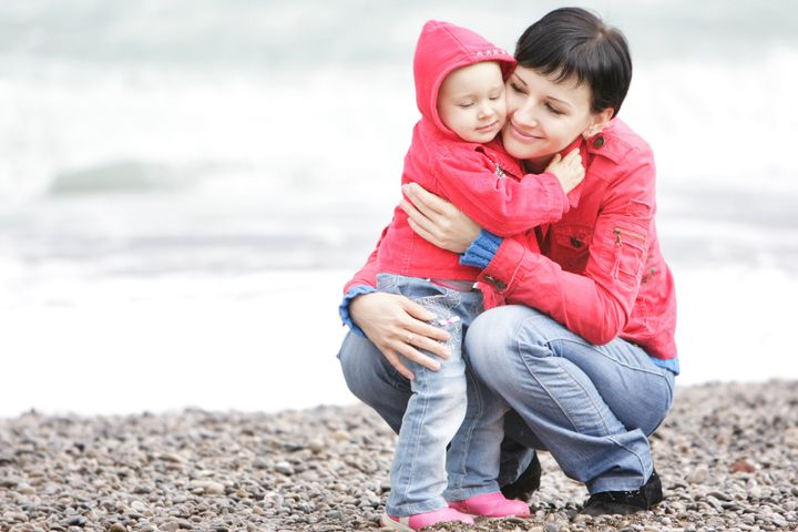 loving mother and daughter on beach