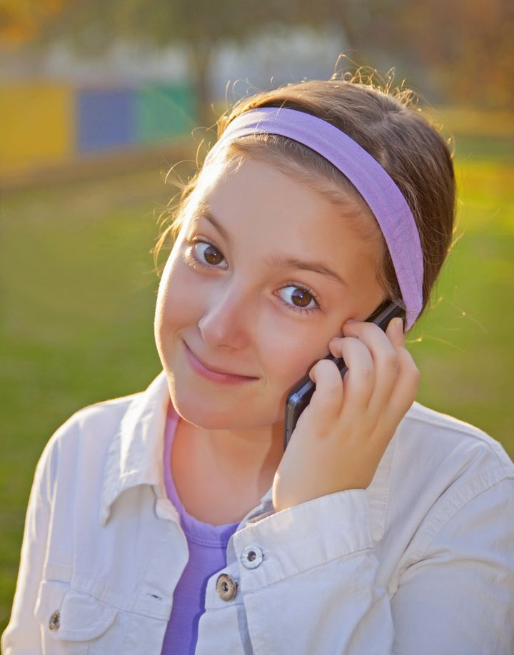 girl speaking on cell phone at...