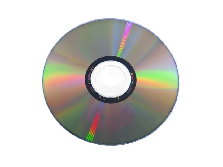 isolated dvd disk on white...