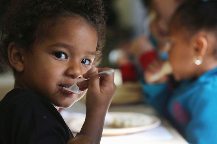 WOODBOURNE, NY - SEPTEMBER 20:  Jiovani, 3, eats breakfast at the federally-funded Head Start Program school on September 20,