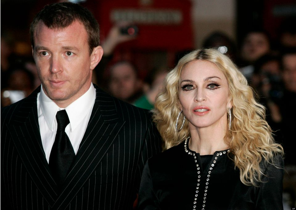 """Madonna <a href=""""http://www.people.com/people/article/0,,20233183,00.html"""">divorced director Guy Ritchie</a> in 2008 after ei"""