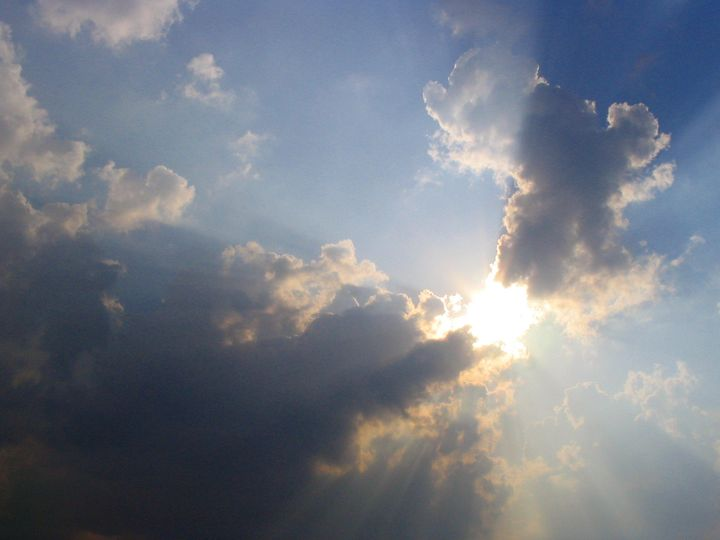 sun breaking through clouds.