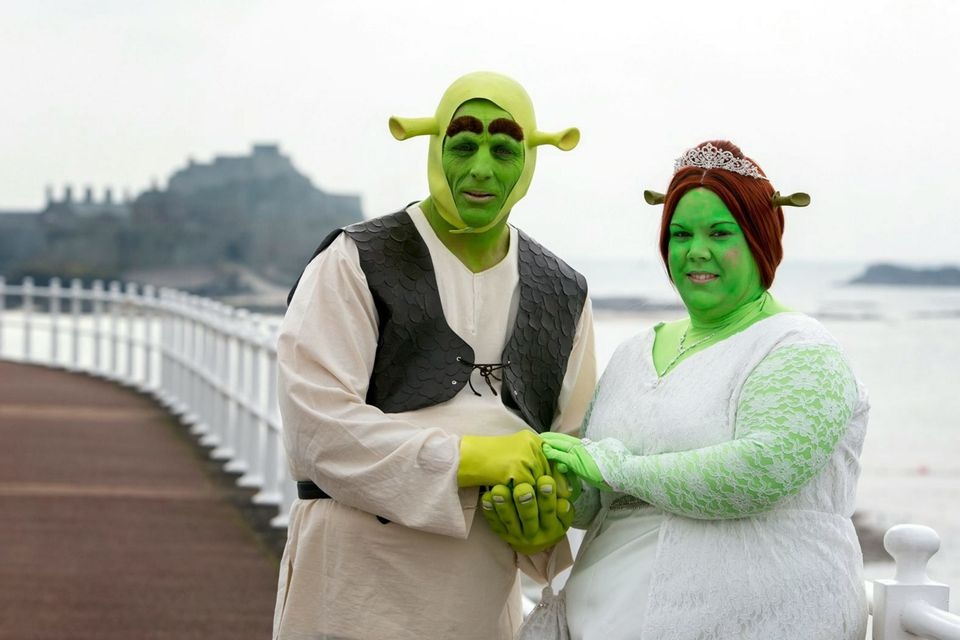 Heidi Coxshall and Paul Bellas dressed as Shrek and Princess Fiona for their wedding.