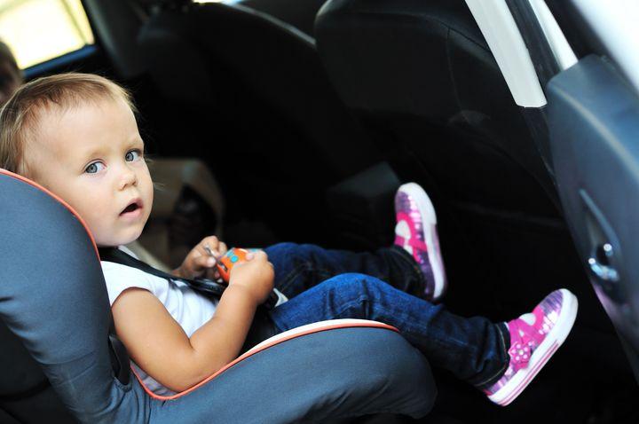 cute toddler girl in car seat