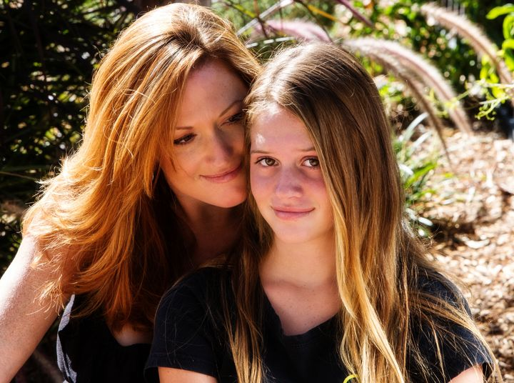 proud mother with pretty teen...