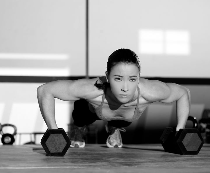 gym woman push up strength...