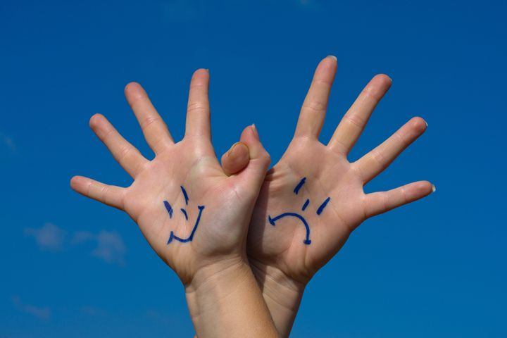 linked hands with smiles and...