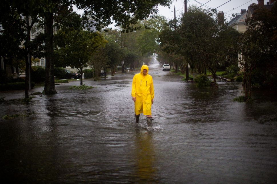 A man walks through flooded streets in New Bern.