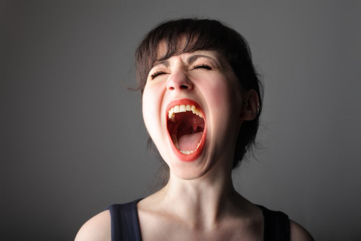 portrait of pretty girl shouting