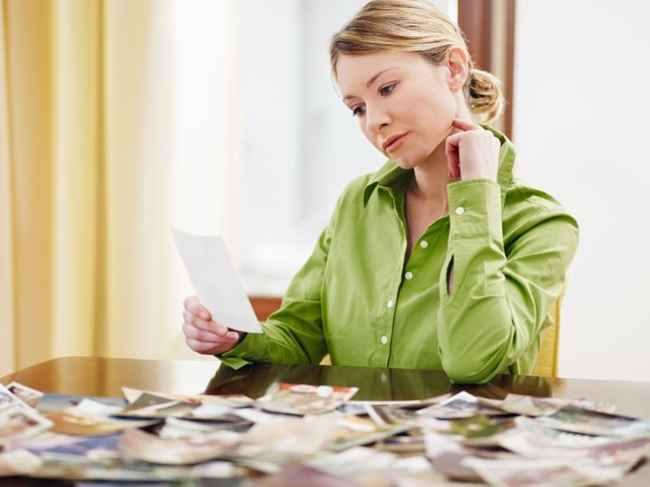woman looking at pictures. Copy space