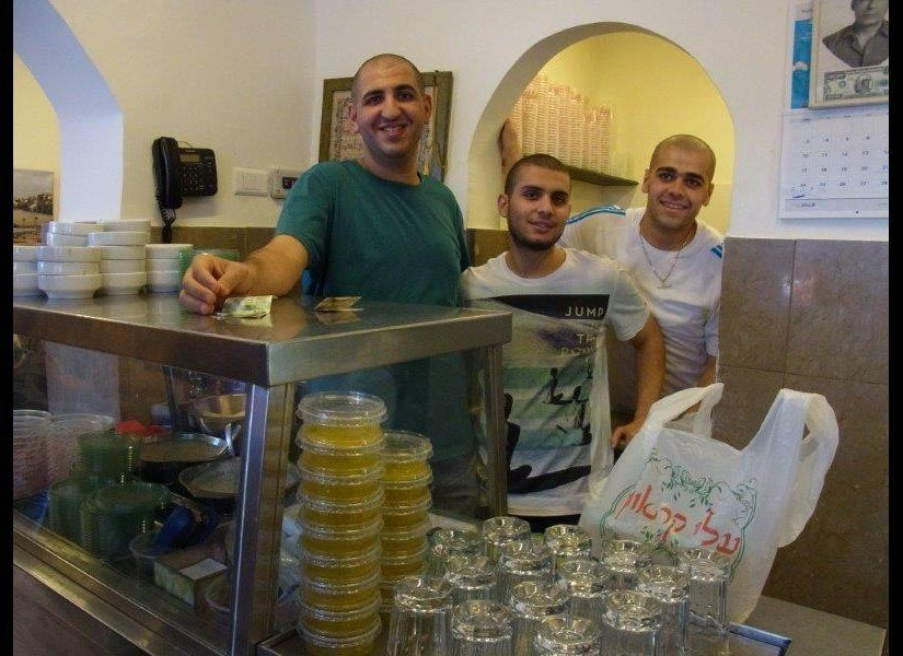 (Left) Honni, the grandson of the late Abu Hassan, with workers in the family's Jaffa humous restaurant.