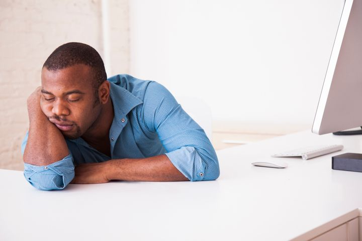 Black businessman sleeping at desk