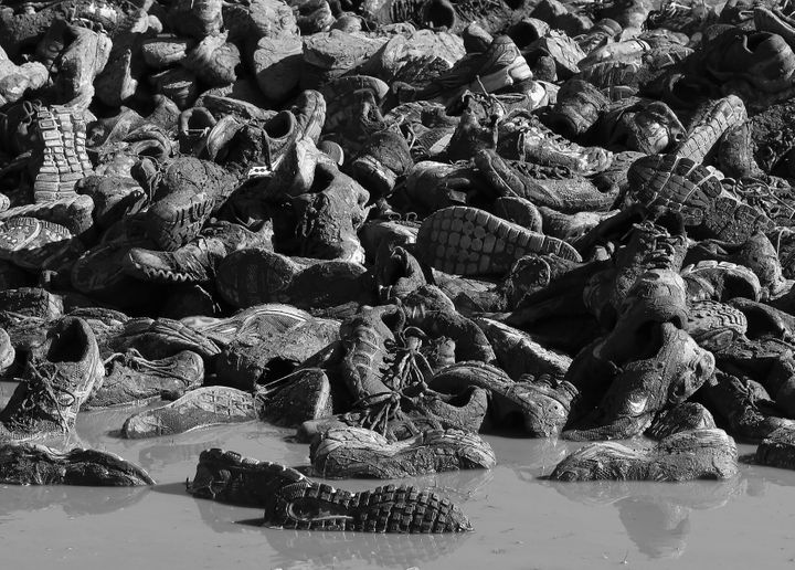 ENGLISHTOWN, NJ - OCTOBER 21:  (EDITOR'S NOTE: This digital image has been converted to black and white) Disgarded sneakers from competitors litter the ground following the Tough Mudder event at Raceway Park on October 20, 2012 in Englishtown, New Jersey.  (Photo by Bruce Bennett/Getty Images)