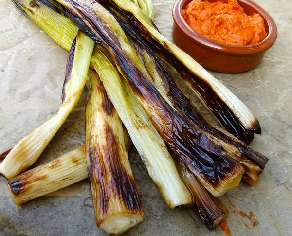 """<strong>Get the <a href=""""http://mayihavethatrecipe.com/2012/05/14/meatless-monday-spring-onions-with-romesco-sauce/"""" target="""""""