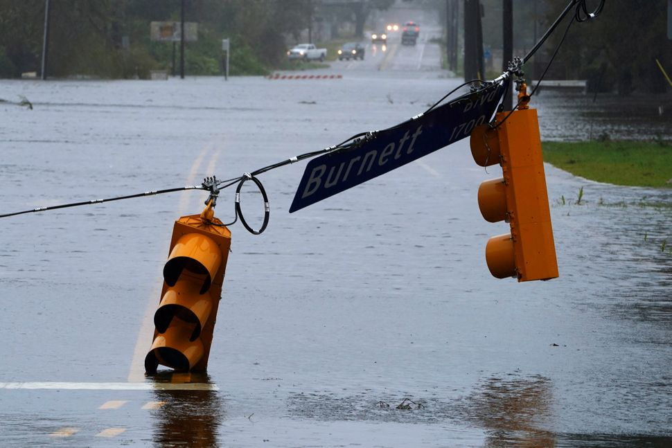 A street light is downed on a flooded road in Wilmington, North Carolina.