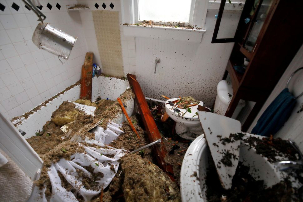 A destroyed bathroom seen in a home in Wilmington, North Carolina.