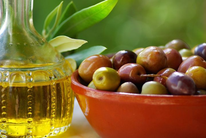 Olive oil and mature olives.