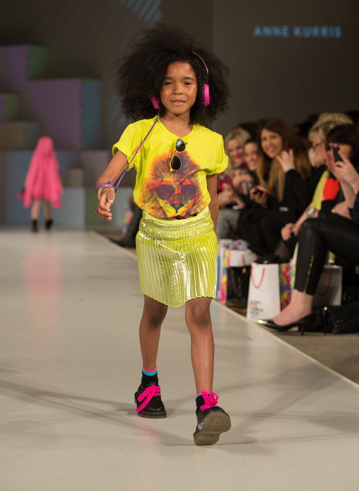 LONDON, ENGLAND - MARCH 20: A model wearing Anne Kurris Spring/Summer '13 walks the runway at the Global Kids Fashion Week SS13 public show in aid of Kids Company at The Freemason's Hall on March 20, 2013 in London, England. (Photo by Ian Gavan/Getty Images for AlexandAlexa.com)