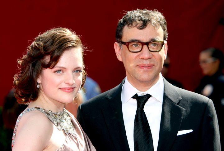 LOS ANGELES, CA - SEPTEMBER 20:  Actors Elisabeth Moss (L) and Fred Armisen arrive at the 61st Primetime Emmy Awards held at