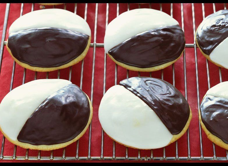 Black and white cookies on a cooling rack. Photo by Mark Thomas / Getty Images.