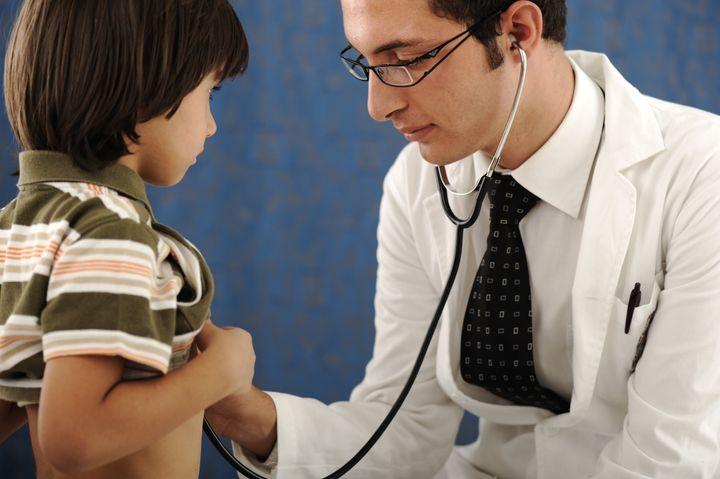 healthy kid boy , visiting a doctor