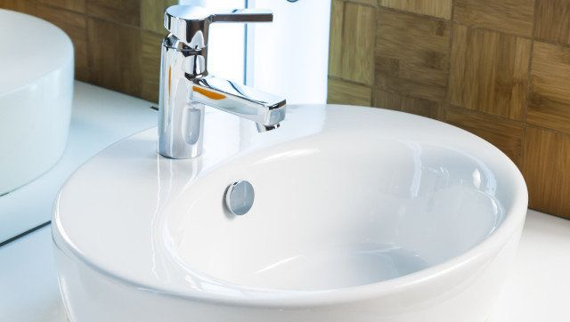 Modern bathroom sink in white ceramic
