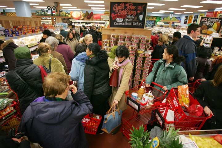 NEW YORK - MARCH 17:  Shoppers line up inside Trader Joe's for the grand opening on 14th Street on March 17, 2006 in New York City.  Trader Joe's, a specialty retail grocery store, has more than 200 stores in 19 states.  (Photo by Michael Nagle/Getty Images)