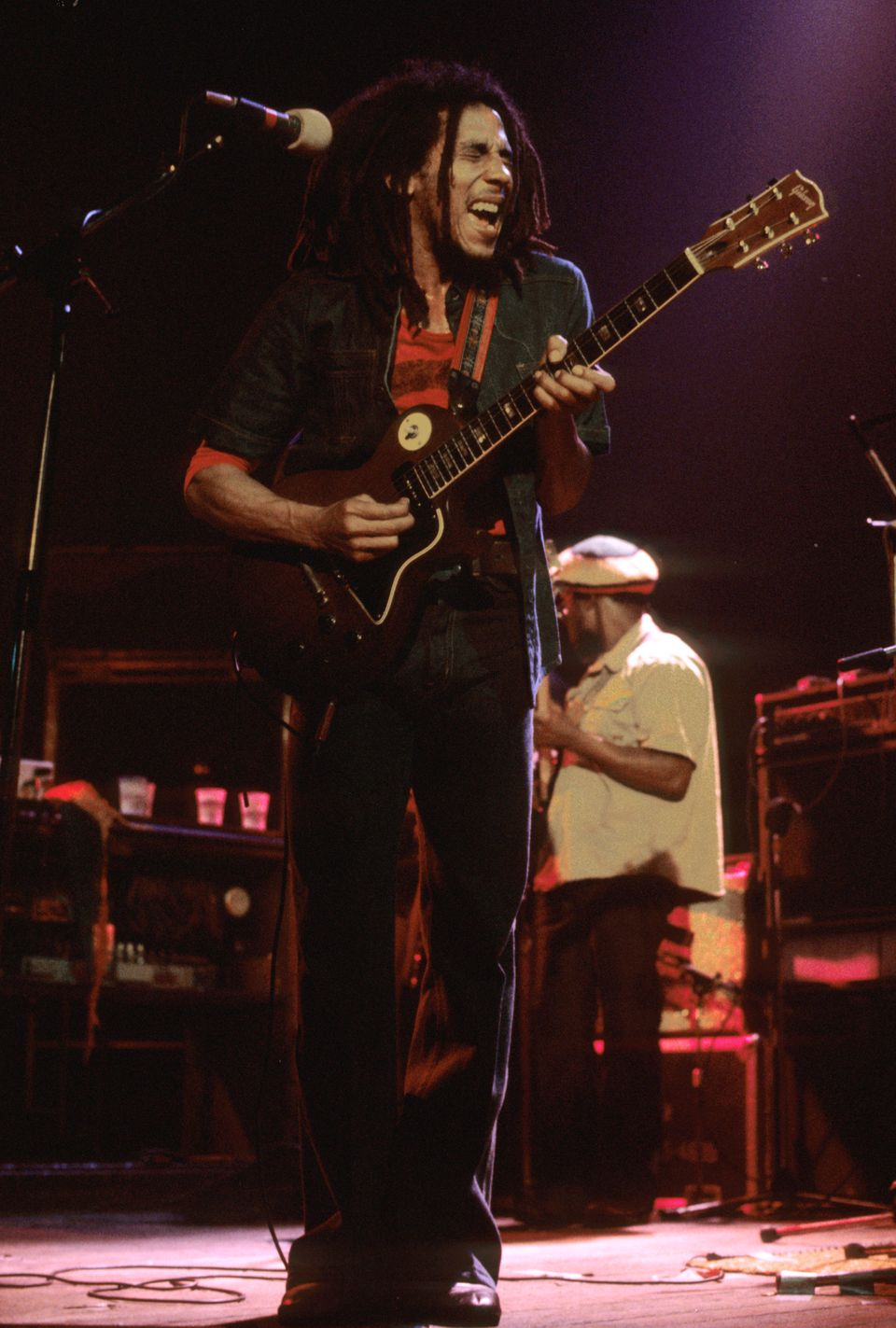 Bob Marley plays his guitar on stage during the gig