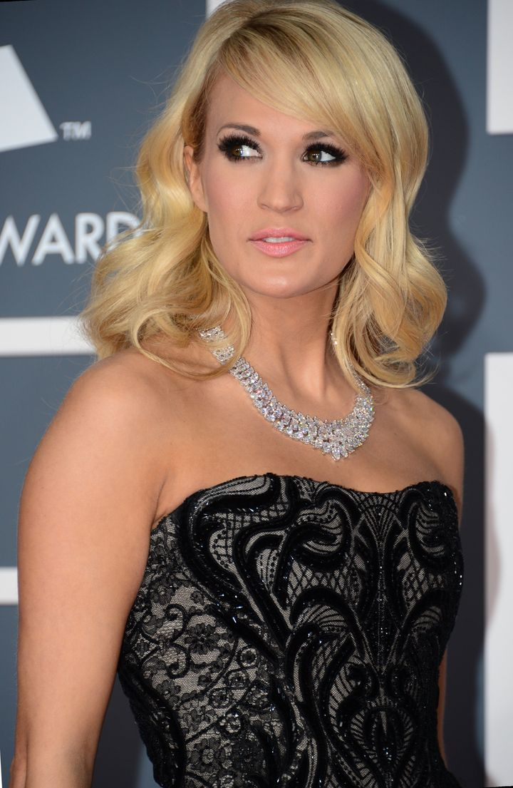 Singer Carrie Underwood arrives at the Staples Center for the 55th Grammy Awards in Los Angeles, California, February 10, 2013. AFP PHOTO Frederic J. BROWN        (Photo credit should read FREDERIC J. BROWN/AFP/Getty Images)