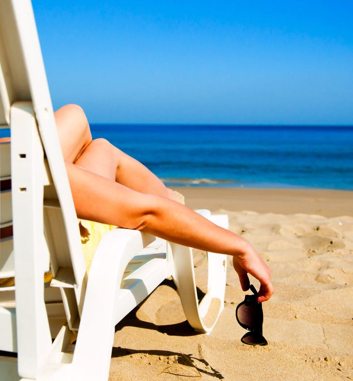 girl lying on a beach lounger...
