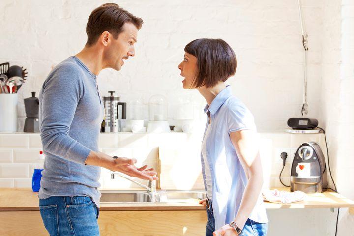 adult heterosexual couple quarreling at home