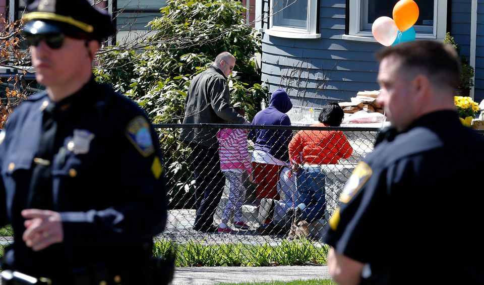 Neighbors come to pay their respects at the Richard house in the Dorchester neighborhood of Boston, Tuesday, April 16, 2013.