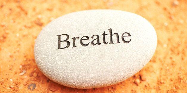 Rock with breathe written on it.