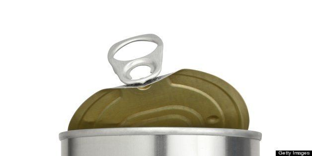 Metal food container with an easy open pull tab top with the lid partially open. Dangerous levels of BPA (Bisphenol A) have been found in some food that is packaged in cans that have a thin plastic lining that contains the chemical.