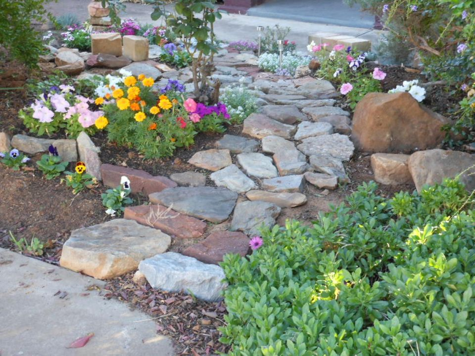 Create a stepping stone path through your lawn or garden by mapping out the path, driving stakes at each end of its destinati