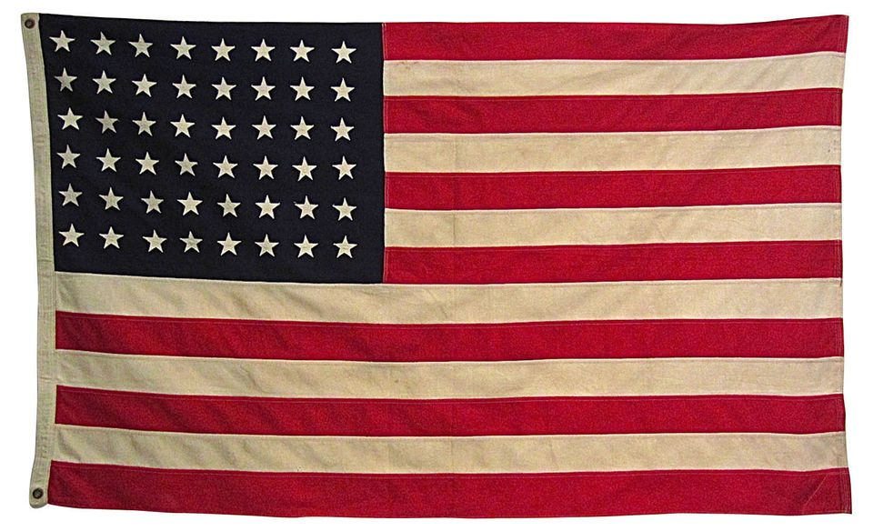 """1950s American flag with metal grommets. Individually pieced and sewn stars and stripes.  <strong>From</strong>: <a href=""""htt"""